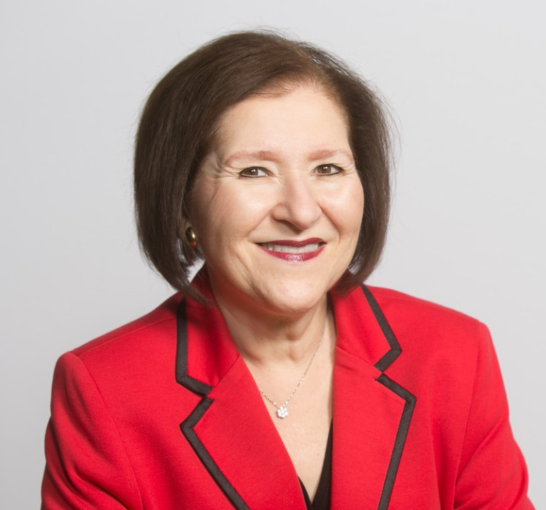Headshot of a woman in a red blazer